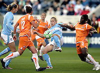 Chicago Red Star forward Ella Masar (3) plays the ball in between Sky Blue FC midfielder Megan Schnur (12) and defender Anita Asante (5).  The Sky Blue FC defeated the Chicago Red Stars 2-0 at Toyota Park in Bridgeview, IL on May 10, 2009.