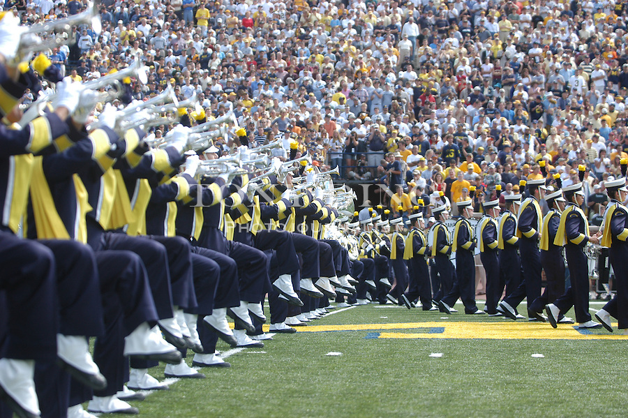 """The Michigan Marching band form the """"M"""" before Michigan's 45-7 victory over Central Michigan at Michigan Stadium on Saturday, August 30, 2003 (TONY DING/Daily)."""