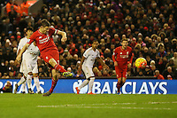 Liverpool's James Milner scores from the penalty spot during the Barclays Premier League match between Liverpool and Swansea City played at The Anfield Stadium on November 29th 2015