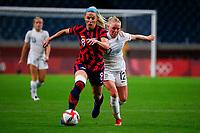 SAITAMA, JAPAN - JULY 24: Julie Ertz #8 of the United States resists Betsy Hassett #12 of New Zealand during a game between New Zealand and USWNT at Saitama Stadium on July 24, 2021 in Saitama, Japan.