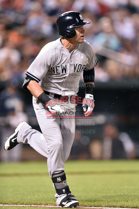 New York Yankees center fielder Jacoby Ellsbury #22 runs to first during a game against the Baltimore Orioles at Oriole Park at Camden Yards August 11, 2014 in Baltimore, Maryland. The Orioles defeated the Yankees 11-3. (Tony Farlow/Four Seam Images)