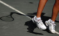 Anabel Medina Garrigues casts her shadow on the clay of stadium court as she serves during her match in the Bausch & Lomb Championships at Amelia Island Plantation on Amelia Island, Fl. (The Florida Times-Union, Rick Wilson)