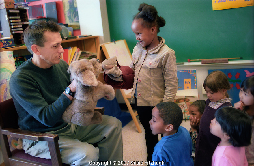 Kindergarten teacher uses puppets to talk with his students about emotional issues. [UW-College of Education 2003: 071890-R1-18a]