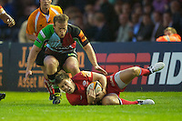 130712 Copyright onEdition 2012 ©.Free for editorial use image, please credit: onEdition..Ali Price of Saracens secures the loose ball as Will Skinner of Harlequins approaches at The Stoop, Twickenham in the first round of The J.P. Morgan Asset Management Premiership Rugby 7s Series...The J.P. Morgan Asset Management Premiership Rugby 7s Series kicked off again for the third season on Friday 13th July at The Stoop, Twickenham with Pool B being played at Edgeley Park, Stockport on Friday, 20th July, Pool C at Kingsholm Gloucester on Thursday, 26th July and the Final being played at The Recreation Ground, Bath on Friday 3rd August. The innovative tournament, which involves all 12 Premiership Rugby clubs, offers a fantastic platform for some of the country's finest young athletes to be exposed to the excitement, pressures and skills required to compete at an elite level...The 12 Premiership Rugby clubs are divided into three groups for the tournament, with the winner and runner up of each regional event going through to the Final. There are six games each evening, with each match consisting of two 7 minute halves with a 2 minute break at half time...For additional images please go to: http://www.w-w-i.com/jp_morgan_premiership_sevens/..For press contacts contact: Beth Begg at brandRapport on D: +44 (0)20 7932 5813 M: +44 (0)7900 88231 E: BBegg@brand-rapport.com..If you require a higher resolution image or you have any other onEdition photographic enquiries, please contact onEdition on 0845 900 2 900 or email info@onEdition.com.This image is copyright the onEdition 2012©..This image has been supplied by onEdition and must be credited onEdition. The author is asserting his full Moral rights in relation to the publication of this image. Rights for onward transmission of any image or file is not granted or implied. Changing or deleting Copyright information is illegal as specified in the Copyright, Design and Patents Act 1988. If you are in any way unsure of your right to