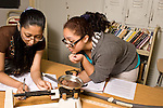"""Education High School science physics class seniors data collection lab on motion building """"roller coaster"""" with marble weighing marble with scale horizontal"""