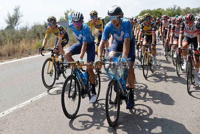 Movistar Team in the peloton during Stage 6 of La Vuelta d'Espana 2021, running 158.3km from Requena to Alto de la Montaña Cullera, Spain. 19th August 2021.    <br /> Picture: Luis Angel Gomez/Photogomezsport | Cyclefile<br /> <br /> All photos usage must carry mandatory copyright credit (© Cyclefile | Luis Angel Gomez/Photogomezsport)