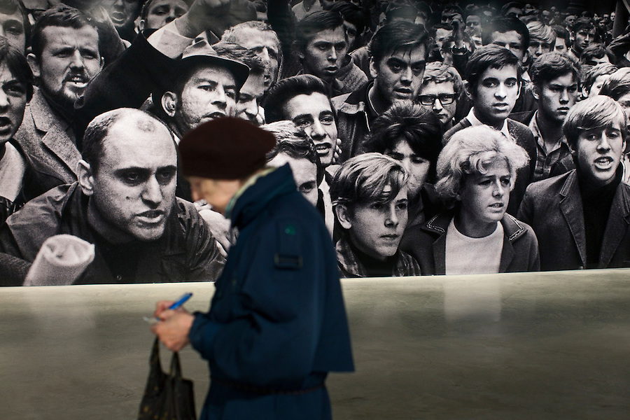 Moscow, Russia, 16/10/2011..A woman copies down anti-Soviet slogans at Prague Invasion 68, Josef Koudelka's first personal exhibition in Moscow, at the Lumiere Brothers Photography Centre. The pictures, shot during the Soviet invasion of 1968, were smuggled out of Czechoslovakia and at first only published anonymously by Magnum; Koudelka only became publicly known as the photographer some 16 years later.
