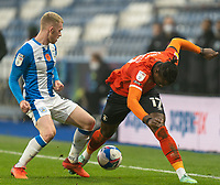 7th November 2020 The John Smiths Stadium, Huddersfield, Yorkshire, England; English Football League Championship Football, Huddersfield Town versus Luton Town; Lewis O'Brien of Huddersfield Town tackles Pelly Ruddock of Luton Town