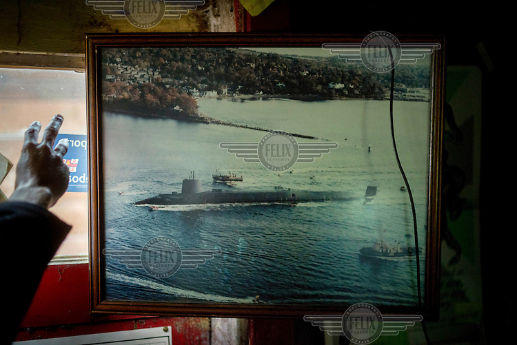 A picture of a nuclear submarine in a communal room at the Faslane Peace Camp, where anti-nuclear protesters have been camped, next to the Faslane base, for 32 years.