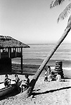 Mazatlan Mexico Beach cafe bar 1970s Children playing on the beach. Women with a stack of car tire inner tubes,  blown up and for rent to use as a rubber ring. in the ocean. 1973