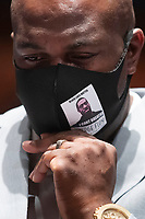 George Floyd's brother Philonise Floyd wears a face mask that depicts the image of his brother while attending the US House Judiciary Committee hearing on 'Policing Practices and Law Enforcement Accountability', on Capitol Hill in Washington, DC, USA, 10 June 2020. The hearing comes after the death of George Floyd while in the custody of officers of the Minneapolis Police Department and the introduction of the Justice in Policing Act of 2020 in the US House of Representatives.<br /> Credit: Michael Reynolds / Pool via CNP/AdMedia