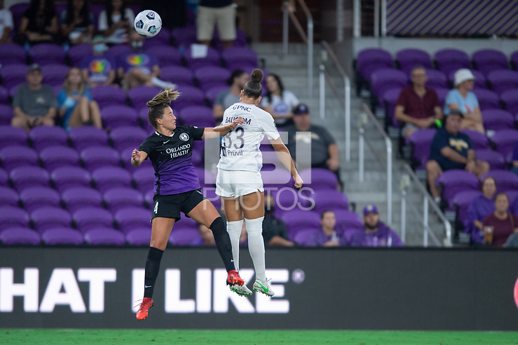 ORLANDO, FL - SEPTEMBER 11: Amy Turner #4 of the Orlando Pride and Jorian Baucom #33 of Racing Louisville FC battle for the ball during a game between Racing Louisville FC and Orlando Pride at Exploria Stadium on September 11, 2021 in Orlando, Florida.