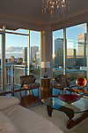 Scudder Condo Living Room view of Richmond downtown at dusk.