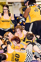 The Bronx Gridlock celebrate a victory over the Brooklyn Bombshells at a Gotham Girls Roller Derby bout in New York City on July 22, 2006.