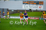 Jack Brosnan of Lixnaw attemps to get rid of the sliotar as Paudie O'Connor of Kilmoyley bares down on him, in round 2 of the County Senior hurling championship