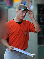 Pitcher Dylan Bundy (6) of the Frederick Keys charts pitches from the dugout in a game against the Myrtle Beach Pelicans on August 4, 2012, at TicketReturn.Com Field in Myrtle Beach, South Carolina. Myrtle Beach won, 4-3. Bundy is the Baltimore Orioles' No. 1 prospect, according to Baseball America. (Tom Priddy/Four Seam Images)