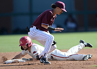 Arkansas left fielder Zack Gregory (left) slides in safely at second base Wednesday, April 7, 2021, as UALR second baseman Jorden Hussein fields the late throw from the plate during the third inning of the Razorbacks' 10-3 win over UALR at Baum-Walker Stadium in Fayetteville. Visit nwaonline.com/210408Daily/ for today's photo gallery. <br /> (NWA Democrat-Gazette/Andy Shupe)