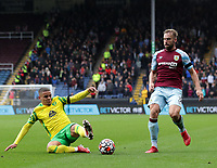 2nd October 2021;  Turf Moor, Burnley, Lancashire, England; Premier League football, Burnley versus Norwich City: Max Aarons of Norwich City slides in to tackle Charlie Taylor of Burnley