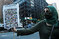 NEW YORK, NY - JUNE 15: A pro-Palestinian woman shows a newspaper with the faces of children killed by Israel during a large protest in New York on June 15, 2021. The solidarity action of hundreds of pro-Palestinians it is a form of support against the attacks carried out by the Israeli government. At the same time, Palestinian Prime Minister Mohammad Shtayyeh says the new Israeli government is just as bad as the old one and condemns Naftali Bennett's announcements in support of Israeli settlements. That is why the demonstrations continue in different parts of the world. (Photo by Pablo Monsalve / VIEWpress via Getty Images