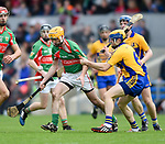 Padraig Ward of Clooney-Quin in action against Seadna Morey of  Sixmilebridge during their senior county final replay at Cusack park. Photograph by John Kelly.