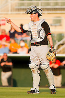 Catcher Justin Dalles #9 of the Delmarva Shorebirds talks to his defense during the game against the Kannapolis Intimidators at Fieldcrest Cannon Stadium on May 21, 2011 in Kannapolis, North Carolina.   Photo by Brian Westerholt / Four Seam Images