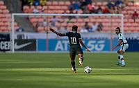 HOUSTON, TX - JUNE 13: Rita Chikwelu #10 of Nigeria crosses the ball during a game between Nigeria and Portugal at BBVA Stadium on June 13, 2021 in Houston, Texas.