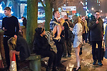 """© Joel Goodman - 07973 332324 . 16/12/2017. Manchester, UK. A man lifts and carries a woman on Deansgate Locks . Revellers out in Manchester City Centre overnight during """" Mad Friday """" , named for historically being one of the busiest nights of the year for the emergency services in the UK . Photo credit : Joel Goodman"""