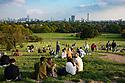 London, UK. 09.10.2021. People enjoy the October afternoon sun, on Primrose Hill, London. Photograph © Jane Hobson.