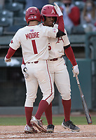Arkansas second baseman Robert Moore (1) is congratulated Wednesday, April 7, 2021, by center fielder Christian Franklin after hitting a solo home run during the fourth inning of the Razorbacks' 10-3 win over UALR at Baum-Walker Stadium in Fayetteville. Visit nwaonline.com/210408Daily/ for today's photo gallery. <br /> (NWA Democrat-Gazette/Andy Shupe)