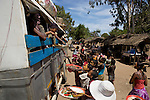 On the dirt road between Tulear and Ifaty. Food sellers and bus..sur la route entre Tule?ar et Ifaty. Vendeuses de poissons se?che?s et bus