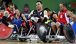 Mike Whitehead (centre) of Harrow, Ont. plows through Andrew Barrow (10) and Troye Collins (8) from Great Britain in the bronze medal game in wheelchair rugby action in Beijing during the Paralympic Games, Tuesday, Sept., 16, 2008.    Photo by Mike Ridewood/CPC