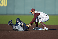 Luke Waddell (7) of the Georgia Tech Yellow Jackets is tagged out by Virginia Tech Hokies shortstop Tanner Schobel (8) as he attempts to steal second base at English Field on April 16, 2021 in Blacksburg, Virginia. (Brian Westerholt/Four Seam Images)