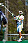 3 April 2010: University of Vermont Catamounts' Defenseman J.J. Newland, a Freshman from Merion Station, PA, in action against the Binghamton University Bearcats at Moulton Winder Field in Burlington, Vermont. The Catamounts defeated the visiting Bearcats 11-8 in Vermont's opening home game of the 2010 season. Mandatory Credit: Ed Wolfstein Photo