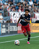 FOXBOROUGH, MA - JUNE 23: Tajon Buchanan #17 of New England Revolution dribbles down the wing during a game between New York Red Bulls and New England Revolution at Gillette Stadium on June 23, 2021 in Foxborough, Massachusetts.
