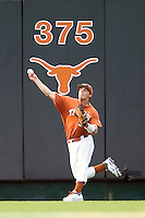 Texas Longhorns outfielder Jonathan Walsh #33 throws to ball back to the infield against the Texas A&M Aggies in NCAA Big XII Conference baseball on May 21, 2011 at Disch Falk Field in Austin, Texas. (Photo by Andrew Woolley / Four Seam Images)