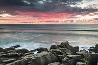 Sunset over limestone formations, Pancake Rocks, in Punakaiki, Paparoa National Park, Buller Region, West Coast, South Island, New Zealand, NZ