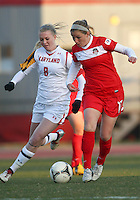 COLLEGE PARK, MARYLAND - April 03, 2013:  Teresa Worbis (17) of The Washington Spirit  defends against Ashley Spivey (8) of the University of Maryland women's soccer team in a NWSL (National Women's Soccer League) pre season exhibition game at Ludwig Field in College Park Maryland on April 03. Maryland won 2-0.