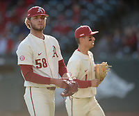 Arkansas reliever Evan Gray returns to the dugout Wednesday, April 7, 2021, after recording the final out of the top of the fifth inning of the Razorbacks' 10-3 win over UALR at Baum-Walker Stadium in Fayetteville. Visit nwaonline.com/210408Daily/ for today's photo gallery. <br /> (NWA Democrat-Gazette/Andy Shupe)
