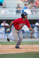 LaMonte Wade (26) of the Elizabethton Twins watches the flight of the baseball as he starts down the first base line against the Kingsport Mets at Hunter Wright Stadium on July 9, 2015 in Kingsport, Tennessee.  The Twins defeated the Mets 9-7 in 11 innings. (Brian Westerholt/Four Seam Images)