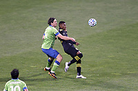 COLUMBUS, OH - DECEMBER 12: Luis Diaz #12 of the Columbus Crew and Gustav Svensson #4 of the Seattle Sounders FC challenge for the ball during a game between Seattle Sounders FC and Columbus Crew at MAPFRE Stadium on December 12, 2020 in Columbus, Ohio.
