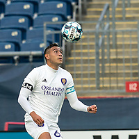 FOXBOROUGH, MA - AUGUST 7: Mateo Rodas #63 of Orlando City B heads the ball during a game between Orlando City B and New England Revolution II at Gillette Stadium on August 7, 2020 in Foxborough, Massachusetts.