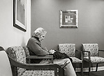 Man in hospital waiting room.