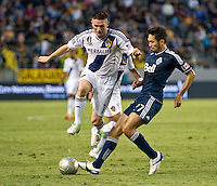 CARSON, CA - June 23, 2012: LA Galaxy forward Robbie Keane (7) and Vancouver Whitecaps midfielder Jun Marques Davidson (27) during the LA Galaxy vs Vancouver Whitecaps FC match at the Home Depot Center in Carson, California. Final score LA Galaxy 3, Vancouver Whitecaps FC 0.