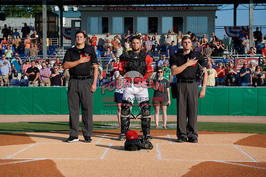 Batavia Muckdogs catcher Andres Sthormes (44) during the national anthem with umpires Tyler Witte (left) and Jesse Busch (right) before a NY-Penn League game against the State College Spikes on July 3, 2019 at Dwyer Stadium in Batavia, New York.  State College defeated Batavia 6-4.  (Mike Janes/Four Seam Images)