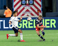 FOXBOROUGH, MA - APRIL 24: Henry Kessler #4 of New England Revolution clears the ball as Yamil Asad #11 of D.C. United closes during a game between D.C. United and New England Revolution at Gillette Stadium on April 24, 2021 in Foxborough, Massachusetts.