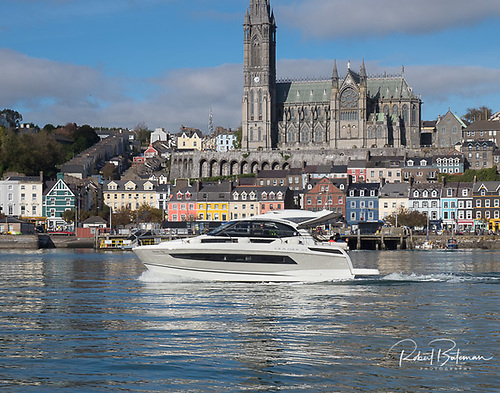 Jeanneau Leader motorboat cruises past Cobh in Cork Harbour