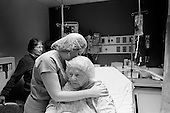 Chicago, Illinois<br /> USA<br /> December 17, 2009<br /> <br /> At the University of Chicago Medical Center Geraldine Martin, 80 years old, is prepared for open heart surgery to have a valve replaced and hole repaired. She is accompanied by her sister Helen Martin prior to the surgery. A nurse takes her pulse.