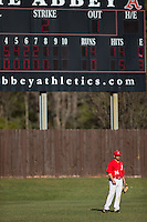 Belmont Abbey Crusaders left fielder Armen Calilao (14) on defense against the Shippensburg Raiders at Abbey Yard on February 8, 2015 in Belmont, North Carolina.  The Raiders defeated the Crusaders 14-0.  (Brian Westerholt/Four Seam Images)