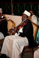 Zanzibar, Tanzania.  Taarab Musicians.  Culture Musical Club. Violin Player.