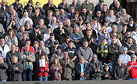 Pictured: Mixed feeling for Swansea supporters as some observe a minute's silence  and some applaud before kick off in memory of Wales football manager Gary Speed who has died. Saturday 27 November 2011<br />